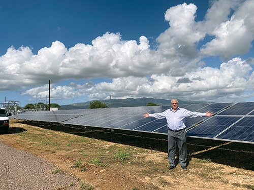 At the Hawaiian blessing and dedication ceremony for the West Loch Solar Project. The PUF team marvels at the large size of the solar project.